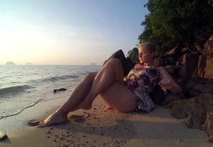 Plump young woman wanking on the beach