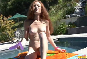 Heather Carolin poolside fake penis..